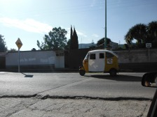 This is a taxi you can take for about 60 to 80 cents a ride if you've crossing town. There are all over the place here.