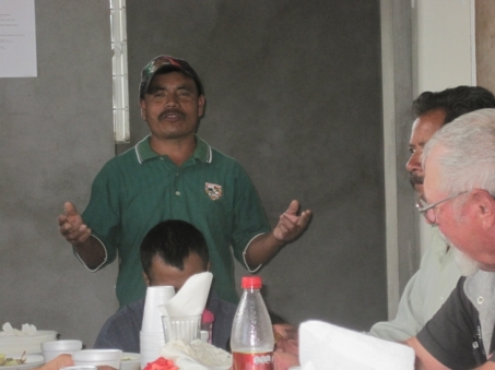 Pastor Beni sharing to everyone about the recent work in Plan De Ayala